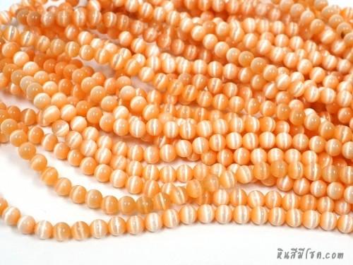 แก้วตาแมว 6 มิล สีส้มอ่อน